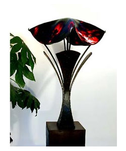 Hand rolled glass and wrought iron lamp